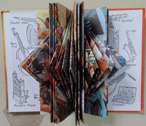 Transforming The Story of Music recycled book sculpture 9.25 x 7 inches Janice Rafael
